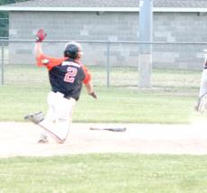 Josh Brown, who had drawn a walk earlier, scores all the way from first base on Andrew Schmidt's sixth inning double, which increased Lake City's lead over Dover-Eyota to 3-1. Schmidt later scored on Jarret Thomas's single for the final 4-1 margin.